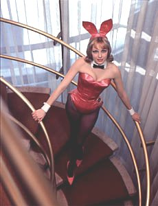 """From Gretchen Edgren's history of the Playboy Club: """"laymate-Bunny Lynn Karrol, Miss December 1961, a spare-time aviatrix and sky-diving buff, elevates both herself and the decor at the New York Club. """" When 'great users of people' are taking, they're seen to be giving."""