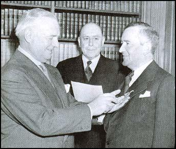 'Wild Bill' Donovan pins a medal on Bill Stephenson, who took over British espionage after Churchill ascended to power.